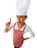 Kitchen staff. Portrait of happy female chef winking to you and keeping her forefinger raised Royalty Free Stock Photo