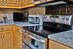 Kitchen Stainless Steel Stove and Cabinets. New Kitchen With Stainless Steel Stove and Wood Cabinets Stock Images