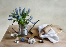 Kitchen still life with grape hyacinths Royalty Free Stock Photography