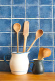 Kitchen still life. interior with retro accessories. Blue tiles ceramic wall background, pitchers vintage wooden spoons. Stock Images