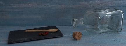 Kitchen still life. Nerja, Malaga, Spain - April 28, 2019: Still life of dark style with various rustic objects like a small lamp, spoon, plate and a small royalty free stock photos