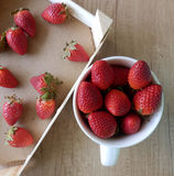 Kitchen still life with strawberries on wooden table Royalty Free Stock Photography