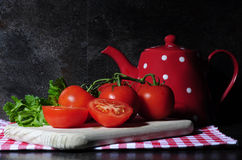 Kitchen still life with tomatos and tea pot Royalty Free Stock Photography