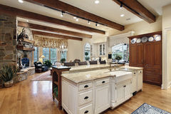 Kitchen with stone fireplace Royalty Free Stock Photography