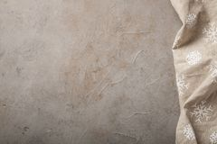 Kitchen stone table with towel. Top view with copy space. Concrete beige background with a touch of rust stock photography
