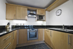 Kitchen with stone worktop Stock Photos