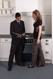 Kitchen store presentation. Young woman talking with a sales representative to buy a kitchen in a kitchen store Royalty Free Stock Images