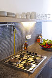 Kitchen Stove. Gas and electric stove in modern kitchen, ready to cook Royalty Free Stock Photo