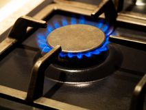 Kitchen stove cook with blue flames burning, closeup. Kitchen stove cook with blue flames burning, macro. Gas flames stock photos