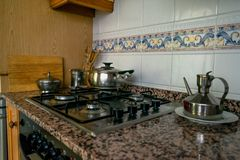 Kitchen stove. Cooking in a kitchen royalty free stock photo