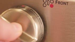Kitchen stove temperature control knob stock footage