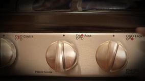 Kitchen stove temperature control knob stock video footage