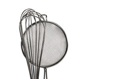 Kitchen strainer and whisk. In chrome Royalty Free Stock Image