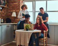 Kitchen in student dormitory. Group of interracial students engaged in education. royalty free stock photos
