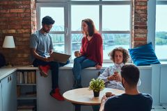 Group of interracial students resting in student dormitory. Kitchen in student dormitory. Group of interracial students resting in student dormitory royalty free stock photos