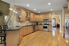 Kitchen with long granite counter Stock Image