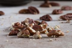 A handful of chopped pecans Stock Image