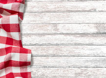 Kitchen table background with red picnic cloth Stock Photography