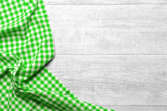 Kitchen table background. A wooden background with a green checkered tablecloth Royalty Free Stock Images