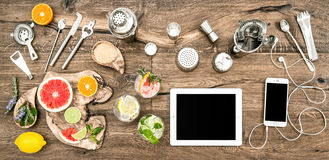 Kitchen table bar tools accessories electronic devices. Kitchen table with bar tools, accessories and electronic devices. Flat lay background Stock Photos