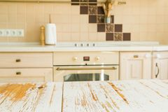 Kitchen table with blur kitchen counter. In background royalty free stock photos