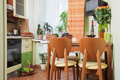 Kitchen Table and chairs with fruit basket. Part of Kitchen interior with table and chairs with fruit basket Stock Photos