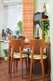 Kitchen Table and chairs with fruit basket. Part of kitchen with table and chairs with fruit basket Stock Photography