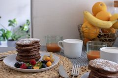 Kitchen table with chocolate pancake royalty free stock photos