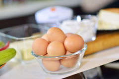 Kitchen table with eggs on basket, focus from top view kitchen table. Royalty Free Stock Image