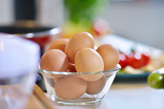 Kitchen table with eggs on basket, focus from top view kitchen table. Royalty Free Stock Photo
