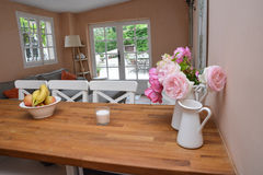 Kitchen table. A kitchen table with flowers & fruits stock images