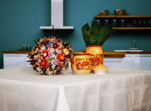 Kitchen  table. Kitchen with table with flowers and ingredient jars Royalty Free Stock Photography