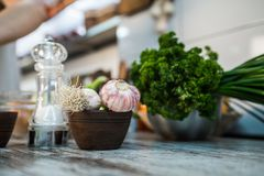 Kitchen table with garlic royalty free stock photo