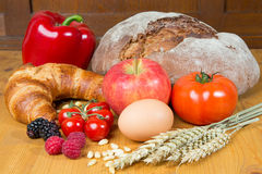 Kitchen table with a lot of food like bread and vegetables Royalty Free Stock Images