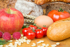Kitchen table with a lot of food like bread and vegetables Royalty Free Stock Photo