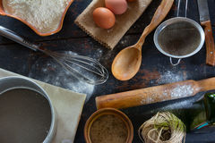 Kitchen table in a rustic style. Products for baking flour, eggs Stock Images