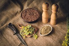 Kitchen, table, sauce, medicinal herbs, grass, flower, flowers, seeds, abacus, notebook, records, recipe, mix, scissors, knife, cu royalty free stock images