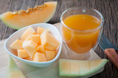 Kitchen table with slice freshness cantaloupe melon and glass of Royalty Free Stock Photos