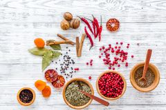 Kitchen table with spices and dry herbs on light wooden kitchen background top view pattern Stock Photo