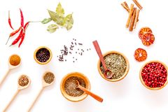 Kitchen table with spices and dry herbs on white kitchen background top view pattern Royalty Free Stock Photography