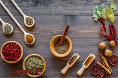 Kitchen table with spices and dry herbs on wooden kitchen background top view Stock Images