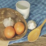 The kitchen table, utensils for cooking, eggs, garlics, top view Stock Photo
