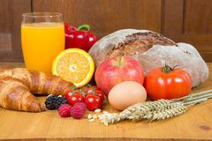 Free Kitchen Table With A Lot Of Food Like Bread And Vegetables Stock Images - 29302724