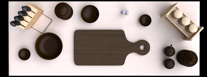 Kitchen table with wooden cutting board and other kitchen bits and pieces. Stock Photos
