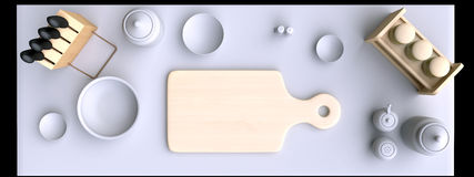 Kitchen table with wooden cutting board and other kitchen bits and pieces. Royalty Free Stock Photos