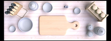 Kitchen table with wooden cutting board and other kitchen bits and pieces. Royalty Free Stock Image