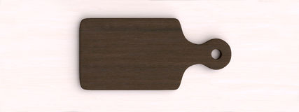 Kitchen table with wooden cutting board and other kitchen bits and pieces. Stock Photo