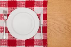 Kitchen. Tablecloth meal dinner plate wood red Stock Photos