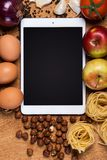 Kitchen. Tablet and food Stock Photo