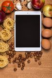Kitchen. Tablet and food Royalty Free Stock Photo